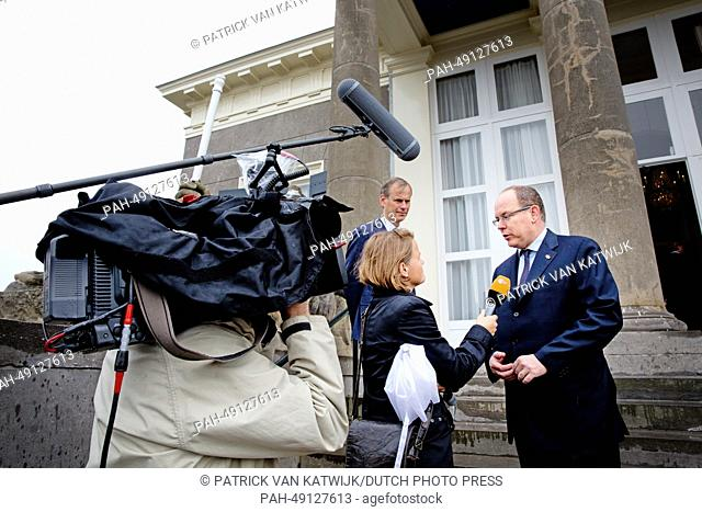 Prince Albert of Monaco (R) during an interview while visiting Pavilion De Witte for a meeting with dredging companies Boskalis and Van Oord in Scheveningen