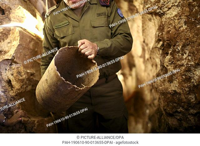 10 June 2019, Israel, Zar'it: An Israeli army serviceman holds an item found in a tunnel dug by the Lebanese Hezbollah Islamist political party and militant...