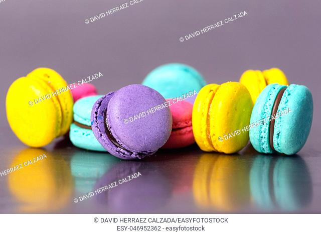 Close up of colorful macarons dessert on purple background