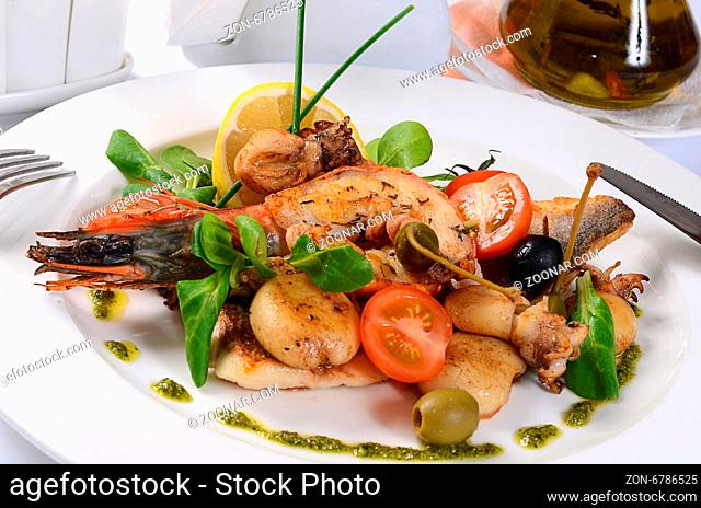 The fried seafood with vegetables close up