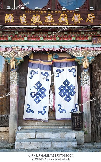 Traditional curtains hang over a shopfront at Zhongdian, also known as Shangri-La, a majority-Tibetan town substantially rebuilt after a disastrous fire in 2014