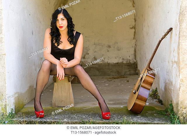 Pretty woman and a guitar