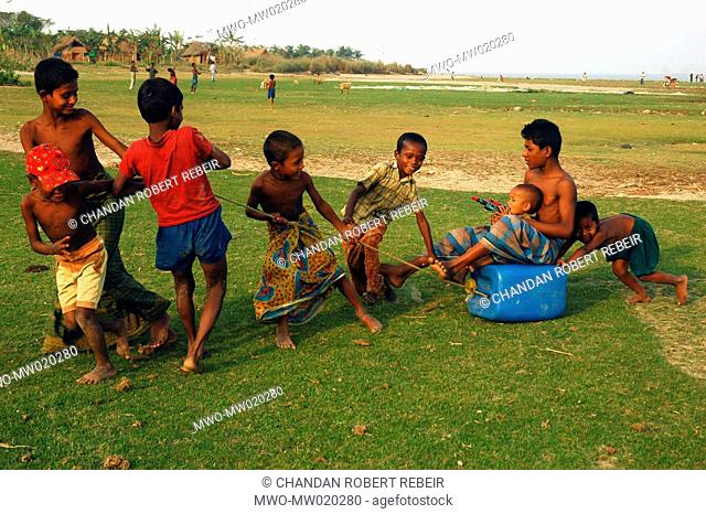 A group of children playing on the shore of the Bay of Bengal, in Dhal Char They are climate refugees from Bhola district losing homes on the bank of the Meghna...