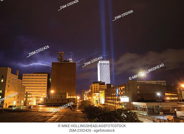 Lightning flashes above Omaha Nebraska and the September 11 memorial lights