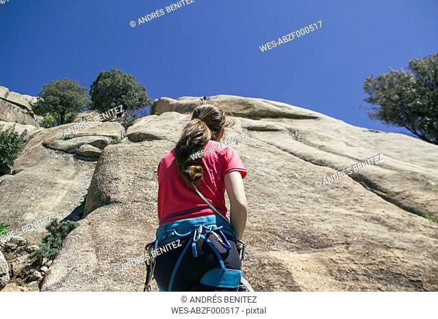Climber woman securing during climbing