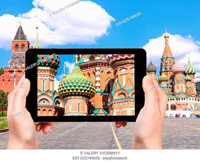 travel concept - tourist photographs picture of Pokrovsky Cathedral on Vasilevsky Descent of Red Square in Moscow Kremlin on tablet pc