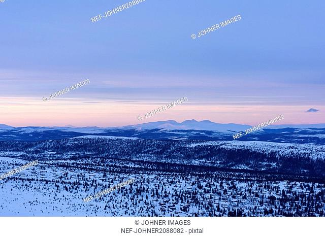 Elevated view of winter landscape at sunset