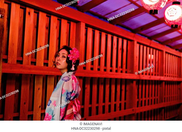 Young woman in Yukata at Matsuri at night