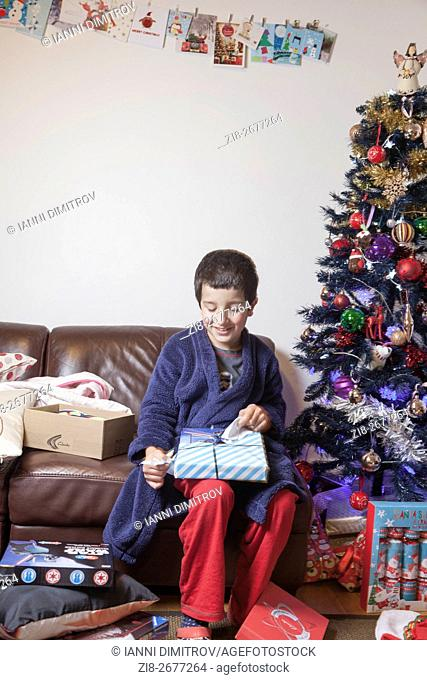 Boy,unwrapping Christmas presents