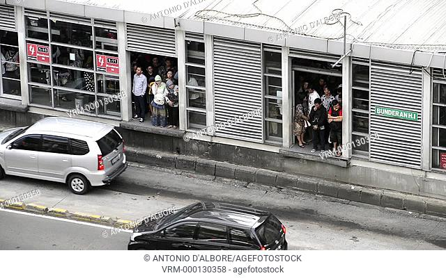 People waiting bus in Jakarta. Indonesia