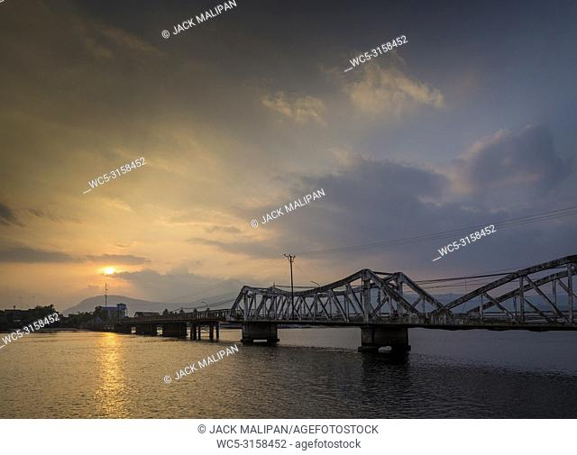 landmark old bridge and river at sunset in kampot cambodia