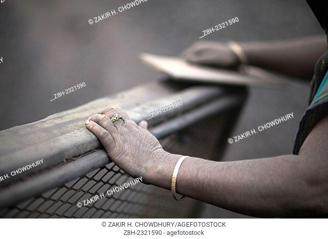 women labor working in dusty environment of waste coal processing by earning Taka 1300 (USD $14) per week and they suffer in lung diseases