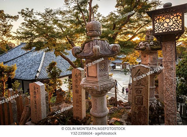 Sunset through stone lanterns, Nigatsudo Hall Shinto shrine, Nara, Japan,