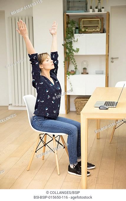 Woman meditating in front of laptop