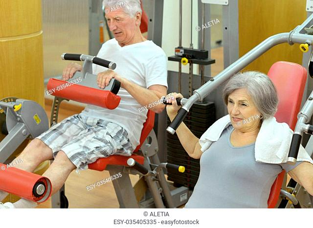 Portrait of senior couple exercising in gym