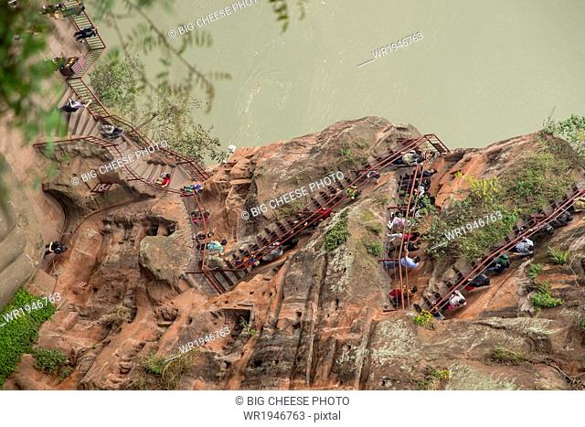 Tourists hiking to the bottom of the Leshan giant Buddha, Sichuan province, China