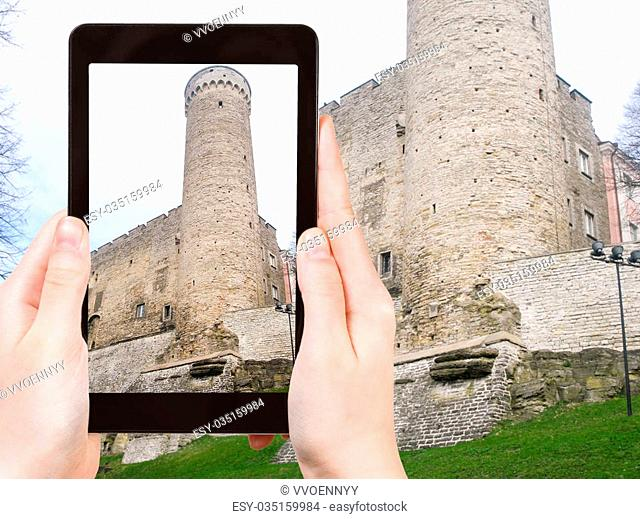 travel concept - tourist photographs tower of Toompea Castle in Tallinn city, Estonia (Toompea linnus) of on tablet pc