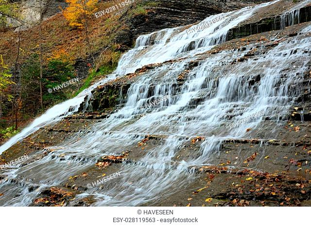 Autumn scene landscape of waterfalls at Buttermilk Falls State Park