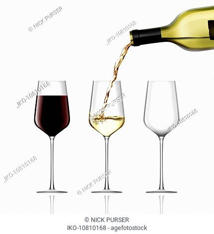 Full glass of red wine next to wine pouring into half full glass of white wine next to empty glass