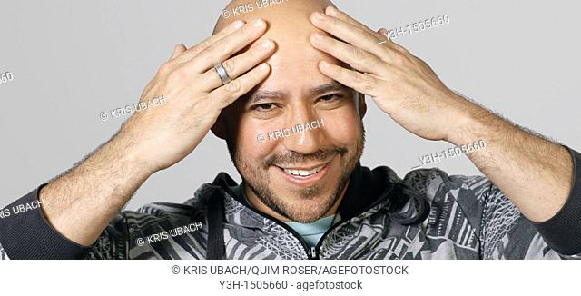 Studio shot of Mexican man, smiling