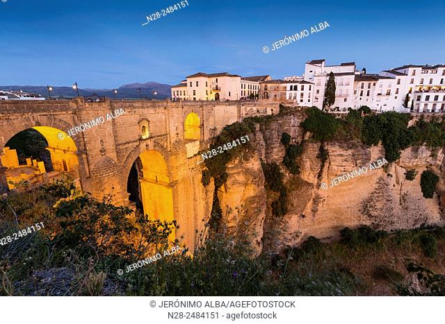 Cliffside, the 'tajo' (canyon) and Puente Nuevo bridge, Ronda, Serrania de Ronda, Malaga province, Andalusia, Spain