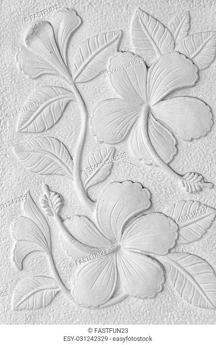 White stone inscription of a China rose, Hawaiian hibiscus, and shoe flower background