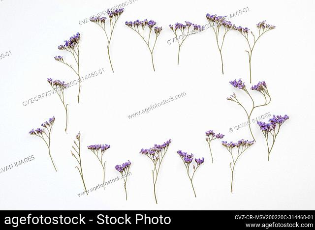Frame made of rustic flowers on table. Copy space