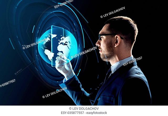 business, augmented reality and future technology concept - businessman in glasses working with transparent tablet pc computer and virtual earth globe hologram...