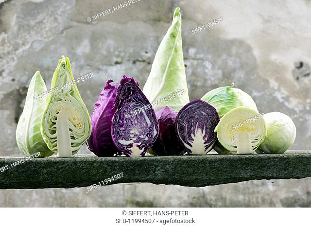 Assorted types of cabbage, whole and halved
