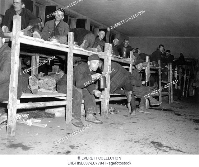 Allied prisoners in the 'Hospital' of a Nazi POW camp captured by the 9th U.S. Army. Over 22,000 prisoners from 11 nations were housed here