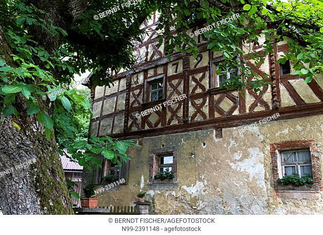 Old framework house from 1792, baroque style, walnut tree, Franconian village, Bavaria, Germany