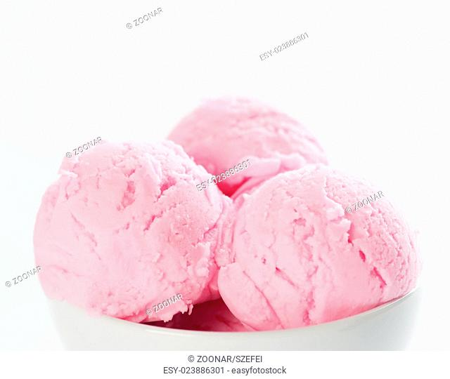 Pink ice cream in bowl with copy space on top