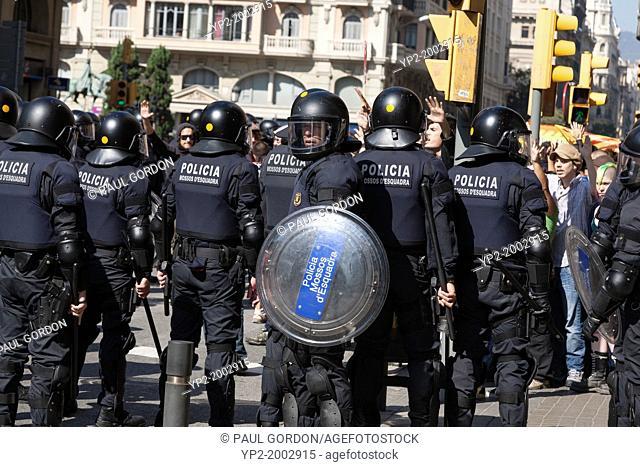Policia Mossos d'Esquadra face protestors in the Gothic Quarter on October 2, 2011 - Barcelona, Catalonia, Spain. Mossos d'Esquadra are the civil police force...