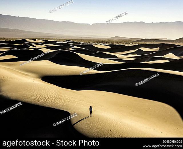 Lone trekker on Mesquite Flat Sand Dunes, Death Valley National Park, Furnace Creek, California, USA