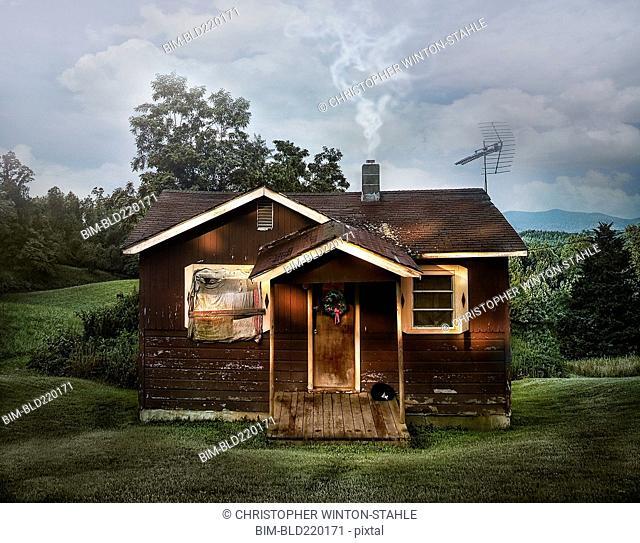 Dilapidated shack in rural field