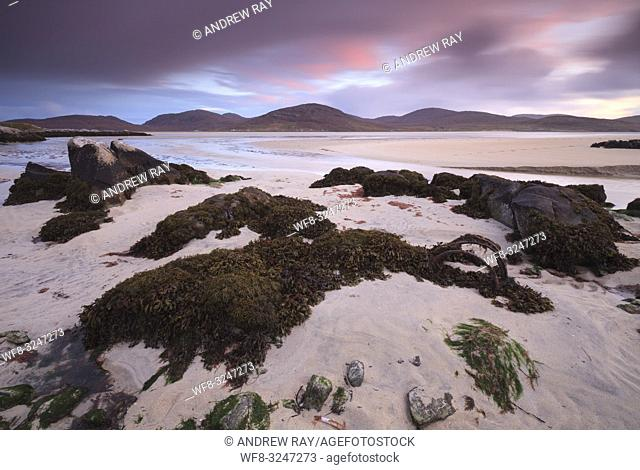 Luskentyre Beach on the Isle of Harris, captured at sunset in early November using a long shutter speed to blur the movement in the clouds