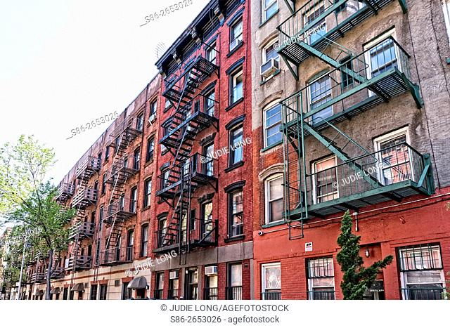 A block long row of Tenement Apartment Buildings in East Greenwich Village, Manhattan, NYC, Formerly known as Alphabet City