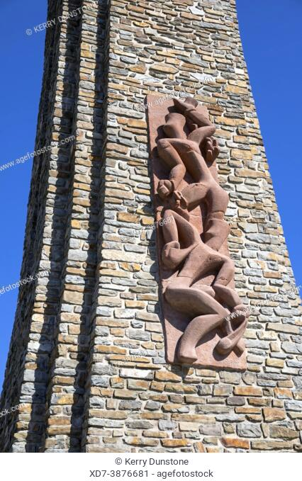 Europe, Luxembourg, Wiltz, Memorial Tower the Nationales Streikdenkmal (Detail, Showing Sculpture of Struggling Workers on Tower Wall)