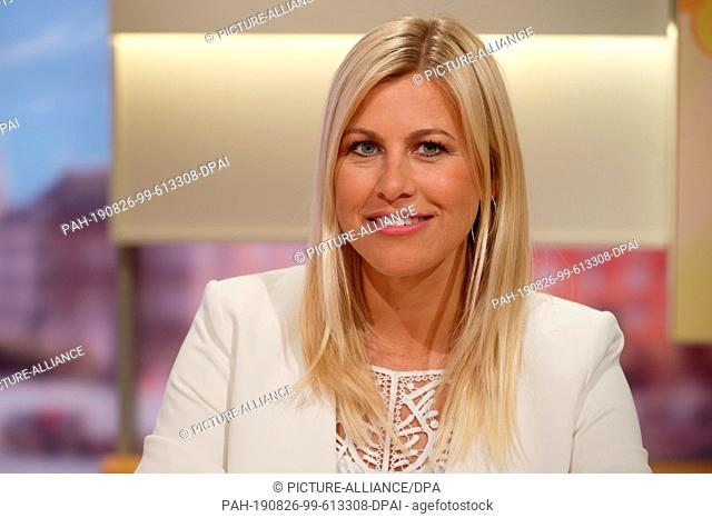 26 August 2019, North Rhine-Westphalia, Duesseldorf: Presenter Nadine Krüger sits in the studio at a photo shoot for the 20th anniversary of the ZDF television...
