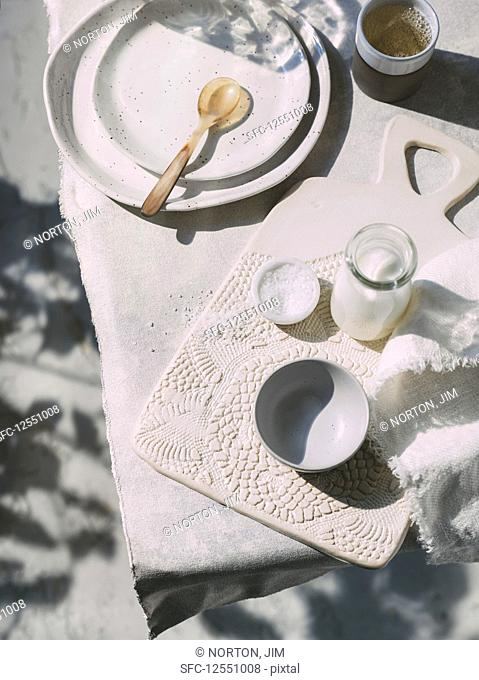 Ceramic dishes, salt and milk on a table