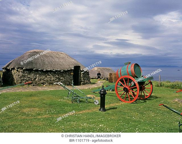 Old cart with barrel and Black House, Skye Cottage Museum, Scotland, United Kingdom, Europe