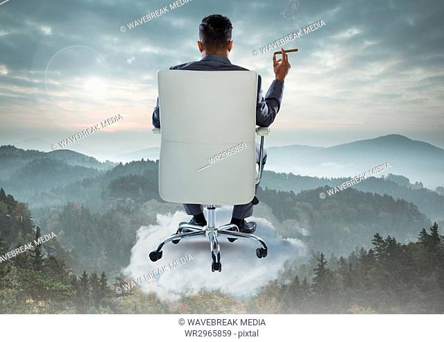 Businessman Back Sitting in Chair with cigar on cloud over mountain landscape