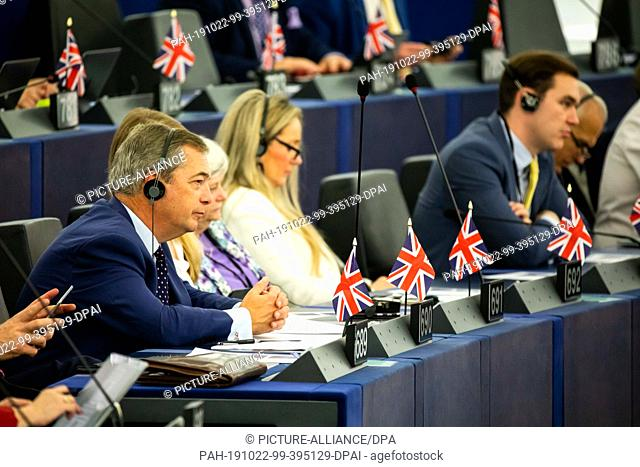 22 October 2019, France (France), Straßburg: Nigel Farage (l), leader of the British Brexit Party, listens in the European Parliament to the debate on the...