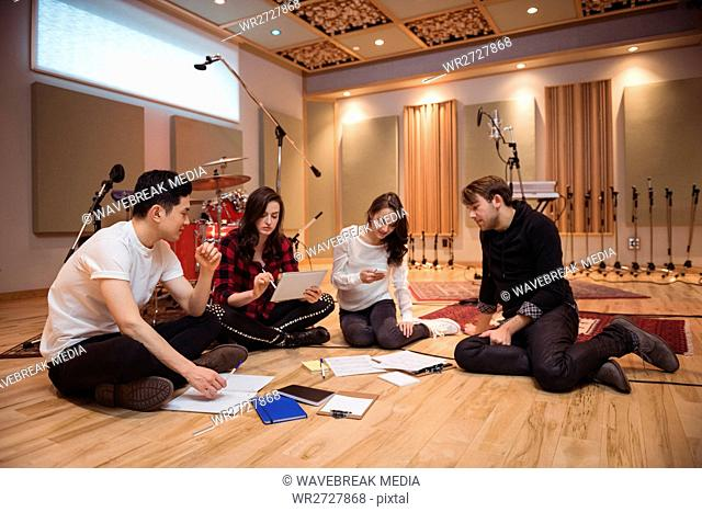 Team of musician composing tune in recording studio