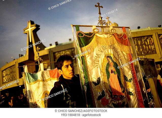 A pilgrim carries a banner with the image of the Our Lady of Guadalupe outside of the Our Lady of Guadalupe Basilica in Mexico City, December 9, 2012
