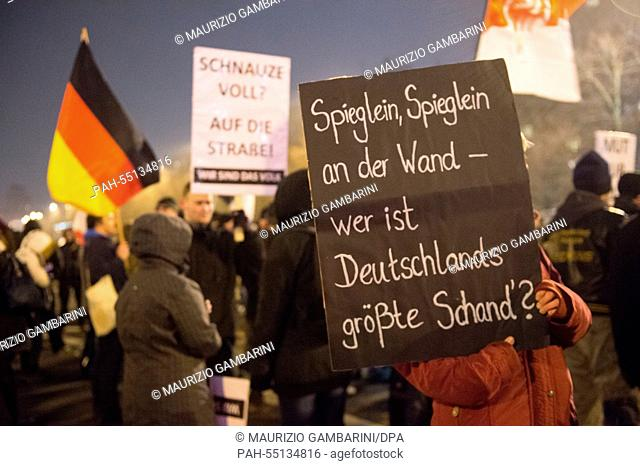 Members of the Islam-critical Bargida movement (Berliner Patriots against the Islamization of the West) demonstrate with a sign that reads 'mirror mirror on the...
