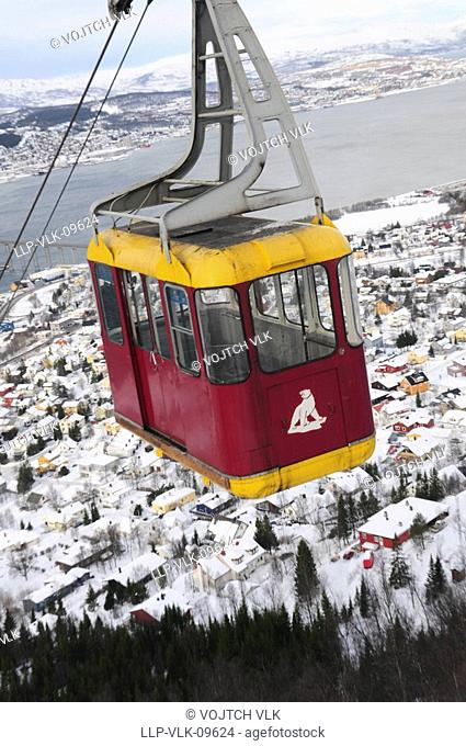 The funicular over the snow-covered town Tromso - north Norway