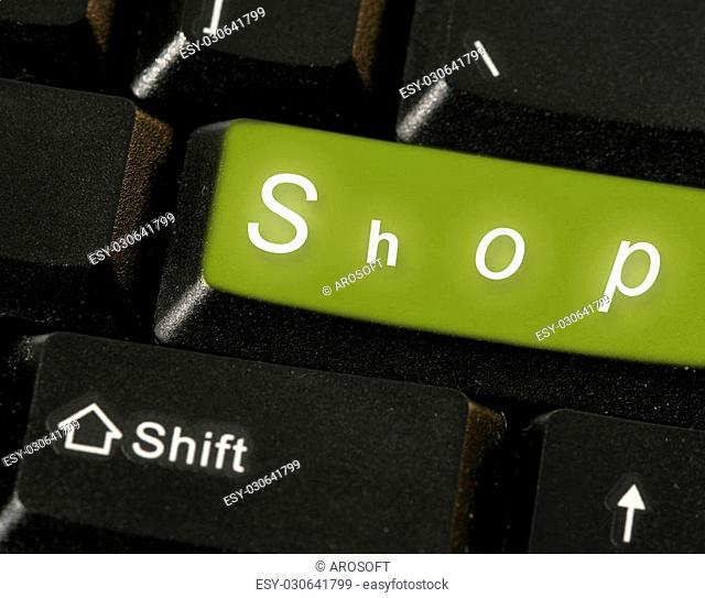 Close-up picture of a computer keyboard - green key shop