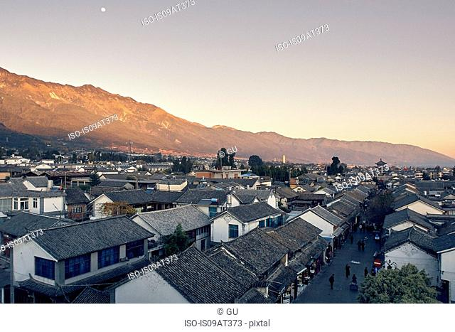 Elevated view of buildings and mountain range, Dali, Yunnan, China