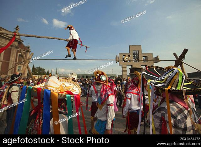 Indigenous ropewalker with stick performing during the celebrations in front of the Basilica on the festival day dedicated to Our Lady of Guadalupe in Mexico...